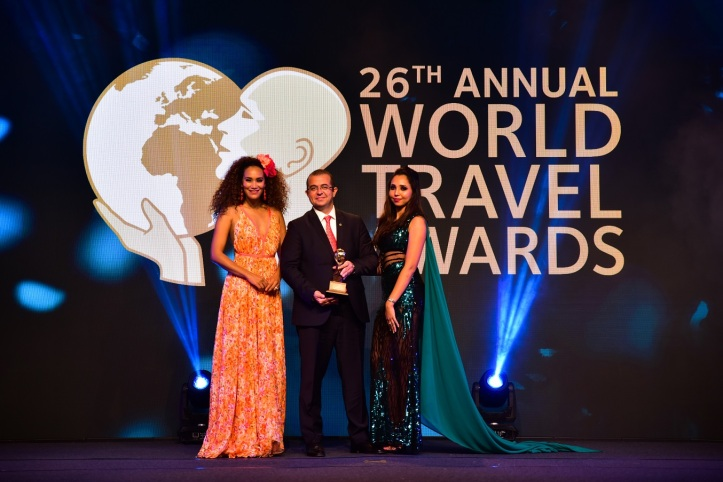 Fraser Suites Abuja General Manager Deniz Isikei (left) receives the award for Nigeria's Leading Serviced Apartments at the 2019 World Travel Awards in Africa.jpg